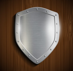 metal shield on a wooden surface