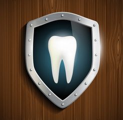 human tooth on the background of the shield