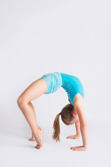Tween girl in gymanstics bridge pose