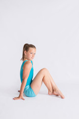 Gymnast girl sitting up straight