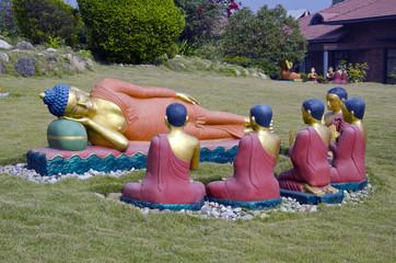 buddha and buddhist monks sculptures in Lumbini, Nepal