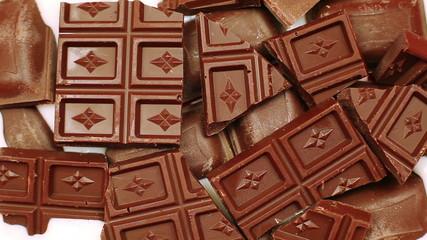 Milk gradually fills chocolate pieces