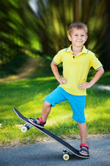 Little boy on a skateboard.