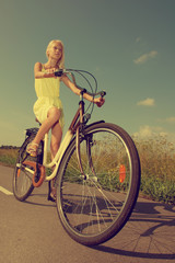 Young girl riding a bike.