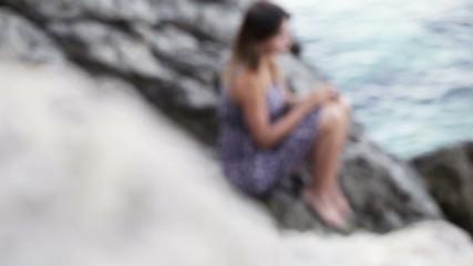Girl in dress on stones