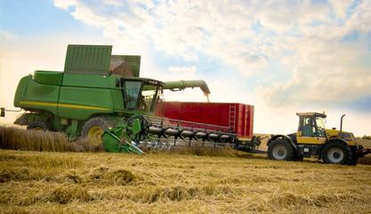 A grain combine with trailer.