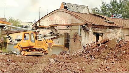 Heavy bulldozer shoveling debris (ZOOM)