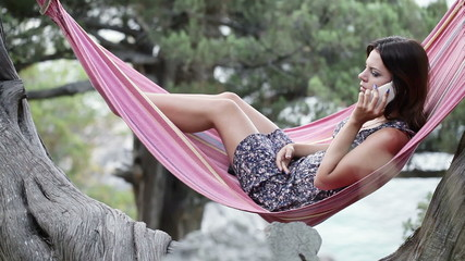 Girl in hammock smartphone