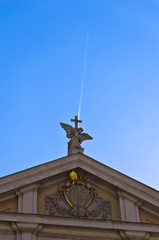 Angel with cross against falling airplane