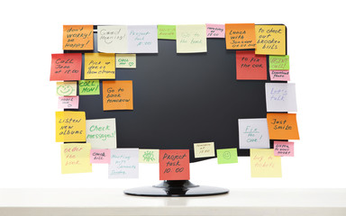 Paper notes on computer monitor
