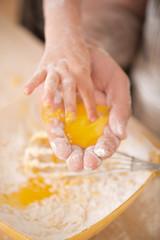 Closeup portrait of little child cooking egg