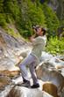Tourist taking photos of a waterfall