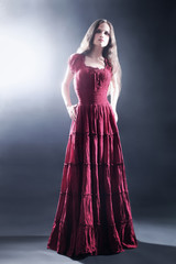 Elegant woman in long dress Fashion model