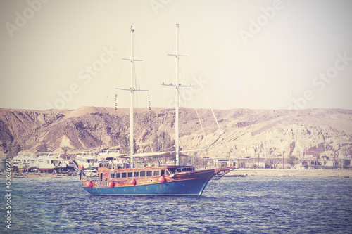 Vintage picture of a sailing boat on the sea in Egypt.