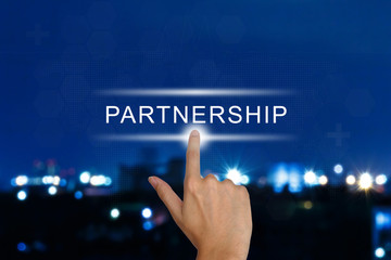 hand pushing partnership button on touch screen