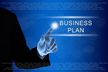 business hand clicking business plan button on touch screen