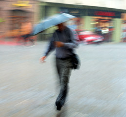 Man walking down the street on a rainy day