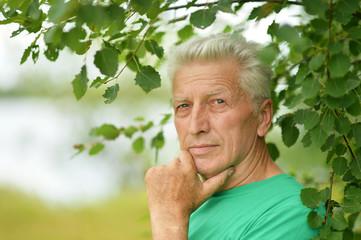 Senior man thinking outddor