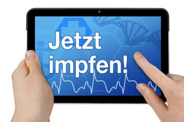 Tablet mit Interface und Jetzt impfen
