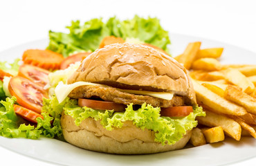 Closeup of home made chicken burgers on plate (Selective Focus)