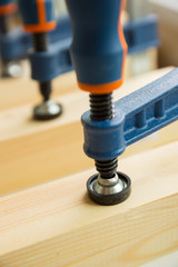 wood pasting by clamps in a joiner's workshop