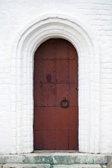 Steel door with white stone arch