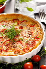 Tart with tomatoes, cheese and herbs