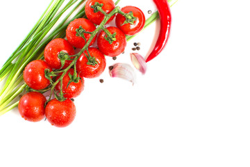 fresh tomatoes with pepper and garlic isolated on white backgrou
