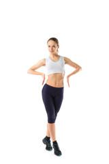 Full body portrait of woman in sportswear, isolated