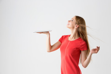winner woman excited holding tablet pc isolated .