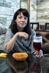 girl sitting at the bar