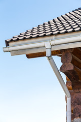 New wooden house with gutter