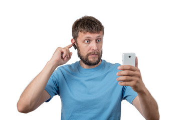 Bearded man wearing headset and smartphone on white background