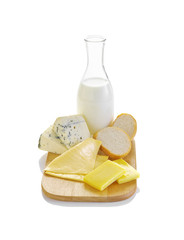 many cheese and milk on white background