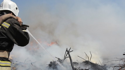 Courageous firefighters extinguish great fire in the open air
