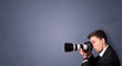 Young photographer shooting images with copyspace area