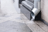 Water flow from drainpipe poster