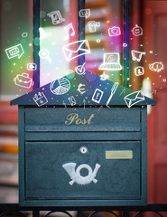 Colorful icons and symbols bursting out of a mailbox