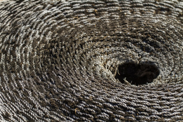 Close view of an old and weathered concentric wicker material.