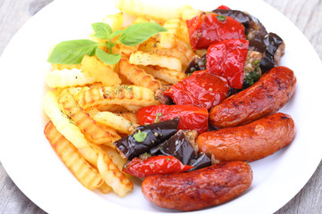 Grilled sausages and fried potatoes