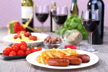 Plate with sausage and potato