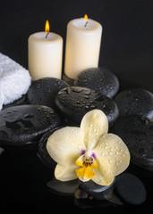 Beautiful spa set of yellow orchid (phalaenopsis), zen stones wi