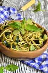 Spaghetti with zucchini and basil pesto.