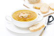 cream soup of yellow lentils with bread, isolated