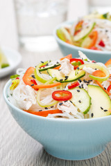 delicious Thai salad with vegetables, rice noodles and chicken