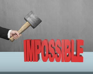 hand holding hammer try to crack impossible 3D word