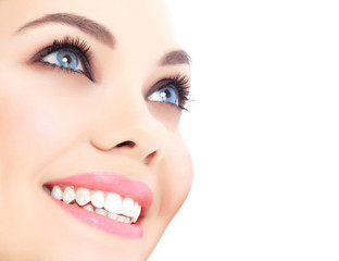 Cheerful female with fresh clear skin, white background.