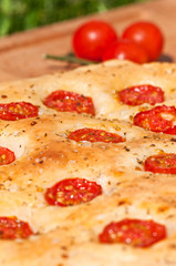 Flatbread with cherry tomatoes (italian focaccia)