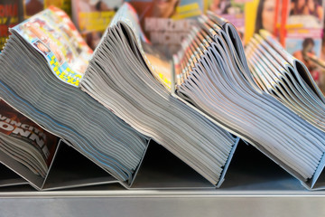 piles of magazines in the kiosk