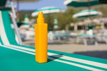sun protection cream on sunbed in the beach